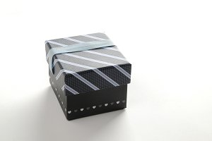 Black gift box with ribbon blue