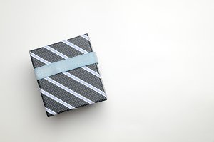 Black gift box with ribbon blue top