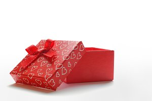 Open red gift with hearts front