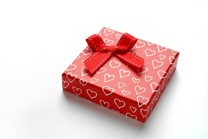 Red gift box with bow and hearts