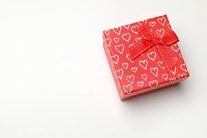 Red gift box with hearts perspective