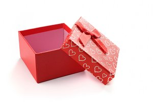 Open red gift box with bow and heart