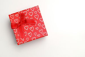 Red gift box with bow and hearts top