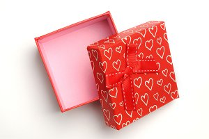 Open red gift with hearts top