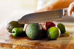 cutting avocados to make guacamole