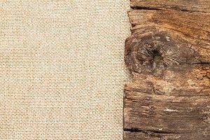Old log on brown sackcloth