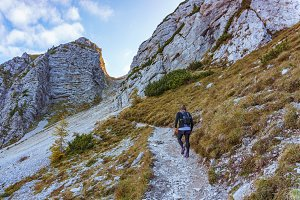 Male hiker walking towards the top