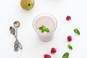 Glass of raspberry and pear smoothie