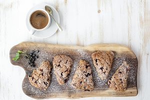 Fresh scones with cup of coffee