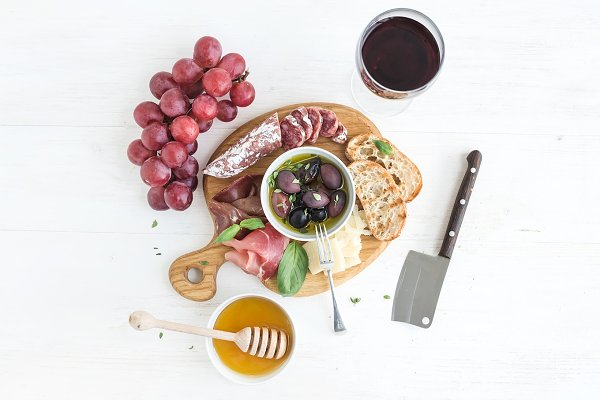 Glass of red wine, grapes and meat