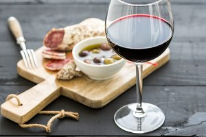 Glass of red wine and French sausage