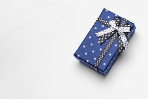 Small blue gift box with ribbon top