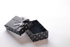 Small open black gift box