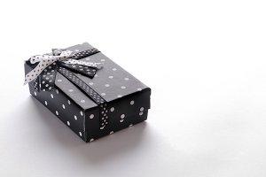 Small black gift box with ribbon