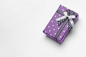 Small purple gift  with ribbon top
