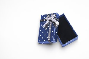 Small open blue gift with ribbon top