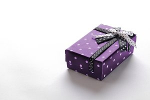Small purple gift box with ribbon