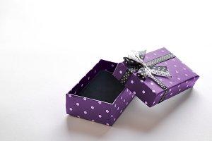 Small open purple gift box