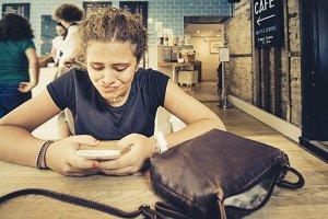 Girl watching a smartphone
