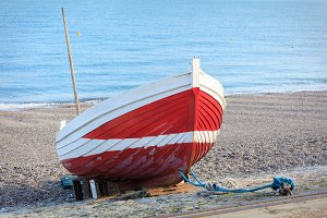 Red boat on the beach