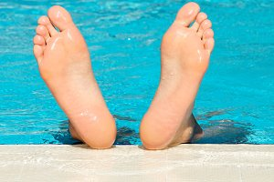 Man's feet with bright blue swimming