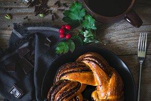 Poppy seed swirl bun and coffee
