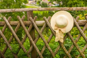 Female summer hat on the fence
