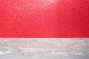 Wood table and red glitter