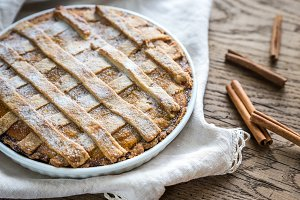 Pumpkin pie on the wooden background