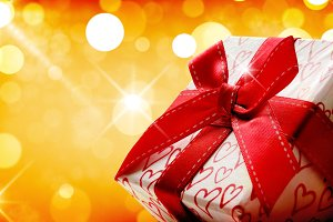 Gift box close up golden bokeh