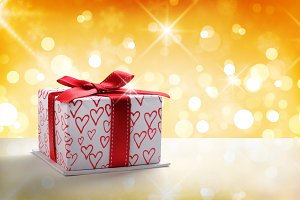 White gift box golden bokeh front