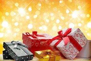 Group gift boxes Golden bokeh