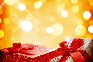 Two decorative gift  golden bokeh