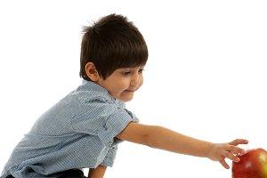 Little Boy Reaching for an Apple