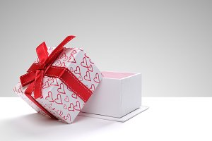 Open gift hearts grey background