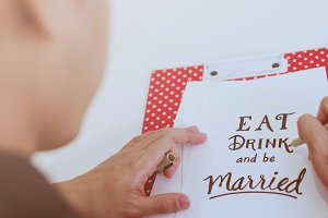 Man writing eat drink and be married