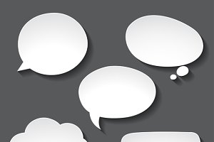 Abstract white paper speech bubbles.