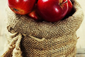 Burlap sack with apples