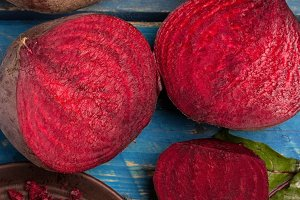 red beet on a blue wooden table