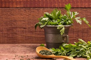 Fresh parsley in a mortar on wooden