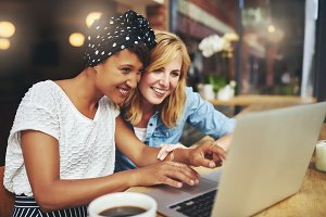 Two females looking at a laptop