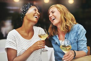 Two friends drinking wine