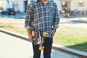 Trendy guy and his skateboard