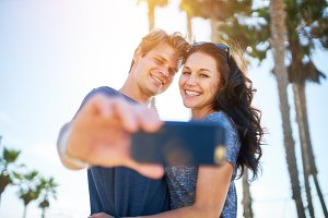 romantic couple taking selfie