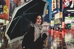 Girl with umbrella in times square