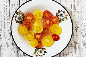 colorful tomato in galvanized bowl  in rural atmosphere.