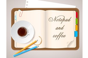 Notepad and coffee cup
