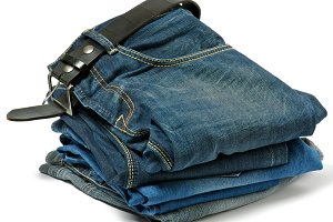 Stack of Old jeans and Belt
