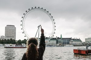Girl pointing to London Eye