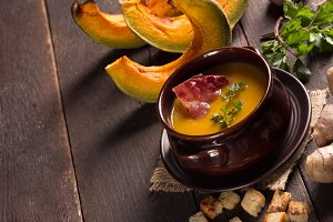 pumpkin soup in a ceramic bowl